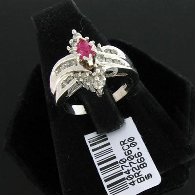 3211: 14 kt. White Gold, 0.27CT Ruby and 0.42CT Diamond