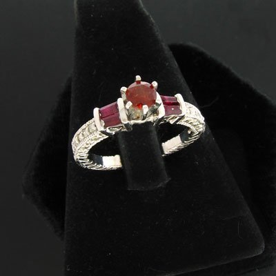 7: APP: 1.3k 14 kt. White Gold, 0.60CT Garnet/Ruby and