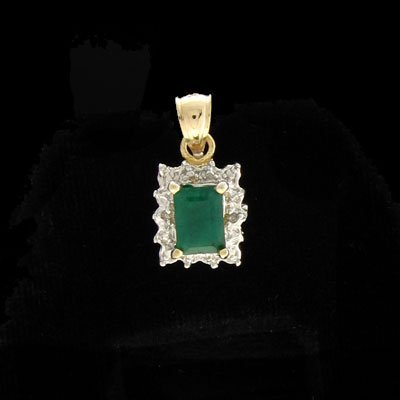 408: APP: 1.1k 14 kt. Gold, 0.95CT Emerald & 0.01CT Dia