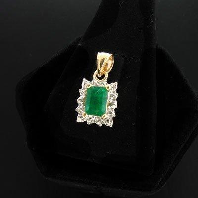 1905: APP: 1.1k 14 kt. Gold, 0.95CT Emerald & 0.01CT Di