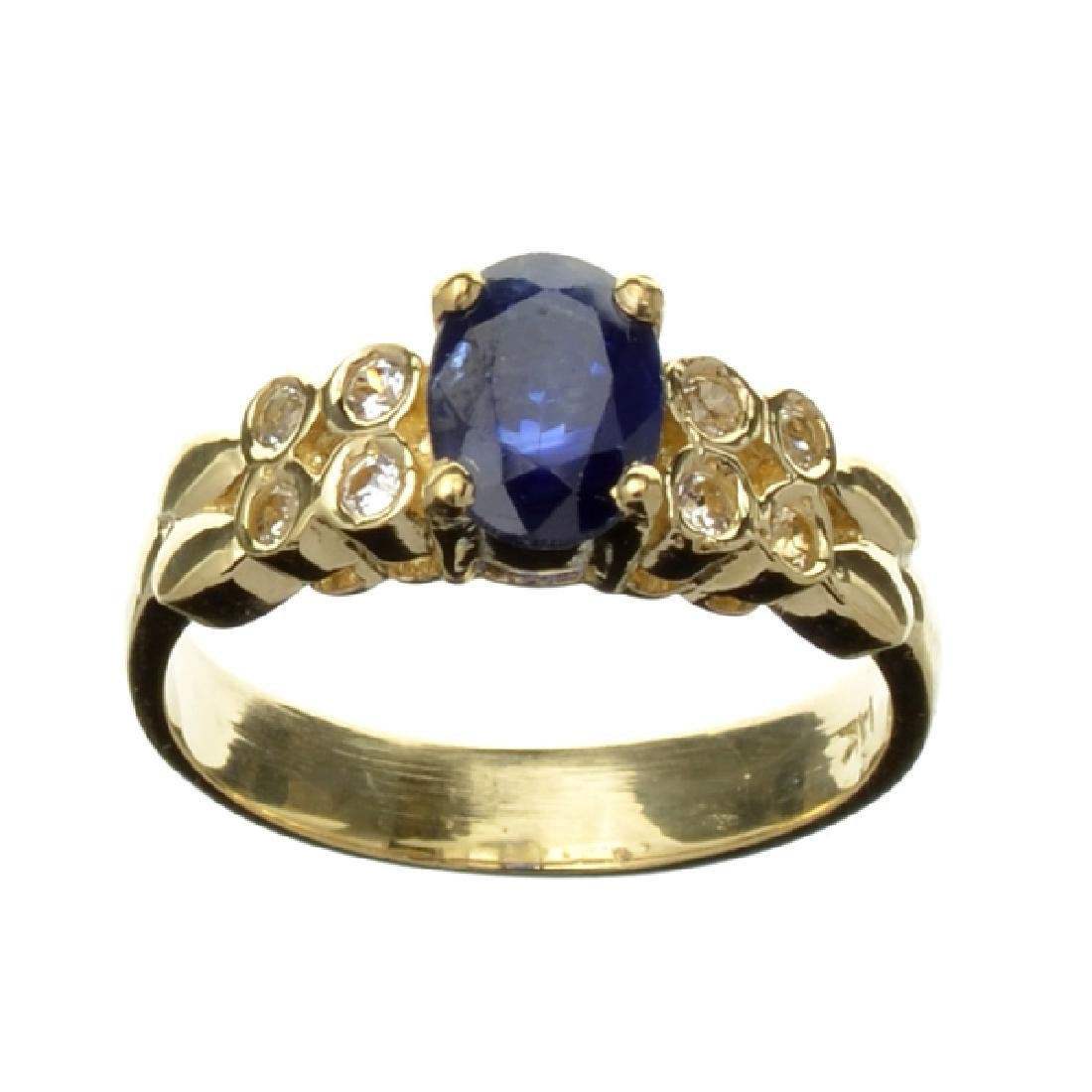 APP: 1.2k 14 kt. Gold, 1.18CT Bue And White Sapphire