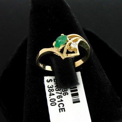 2923: 14 kt. Gold, 0.16CT Emerald & 0.02CT Diamond Ring