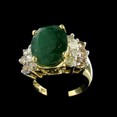 83: APP: $17.9k 14 kt. Gold, 6.43CT Emerald and 1.40CT