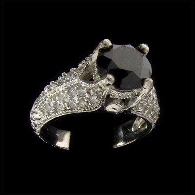 131: APP: $5.7k 14 kt. Gold, 1.67CT Rare Black Diamond