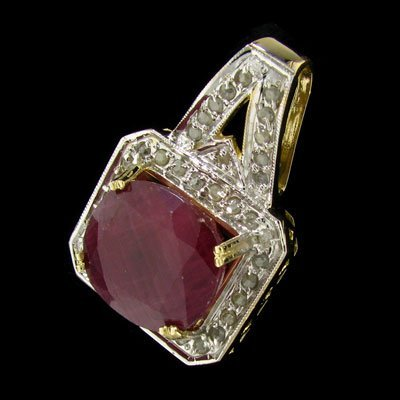 129: APP: 43.2k 14 kt. Gold, 32.20CT Ruby and Diamond P