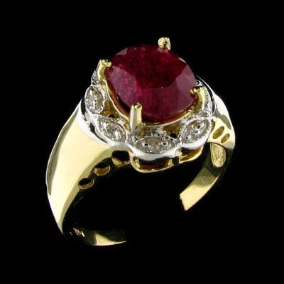 25: APP: 5.6k 14 kt. Gold, 2.46CT Ruby and Diamond Ring