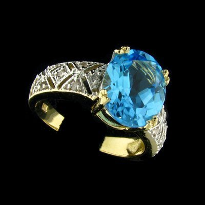 2843: APP: 1.7k 14 kt. Gold, 3.90CT Topaz and Diamond R