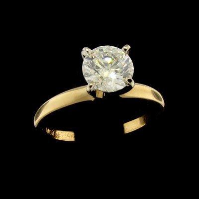 528: APP: 7.2k 14 kt. Gold, 0.96CT Diamond Ring