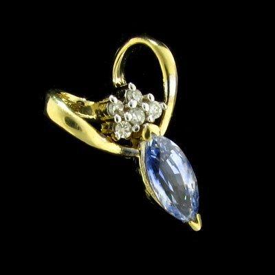 844: 14 kt. Gold, Tanzanite and Diamond Pendant