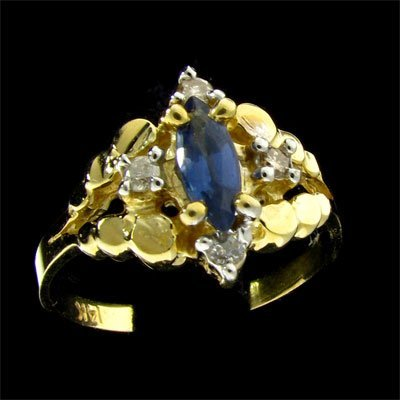43: 14 kt. Gold, 0.40CT Tanzanite and Diamond Ring