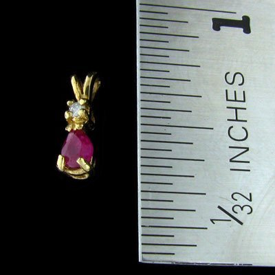 7: 14 kt. Gold, Ruby and Diamond Pendant