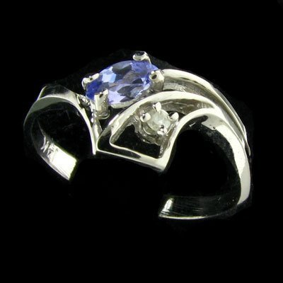 47: 14 kt. White Gold, 0.13CT Tanzanite and Diamond Rin