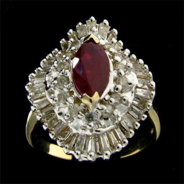 49: APP: 7.2k 14 kt. Gold, 0.68CT Ruby and Diamond Ring