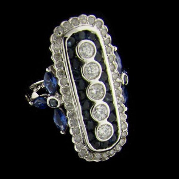 APP: 7k 14kt. W Gold .92CT Blue Sapphire & Diamond Ring
