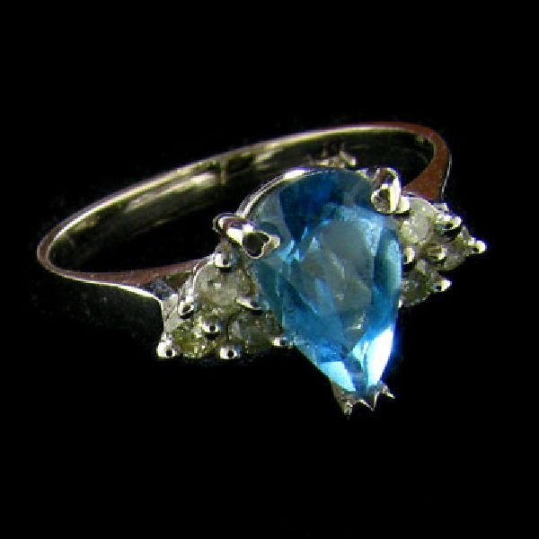 14 kt. White Gold, 1.50CT Blue Topaz and Diamond Ring