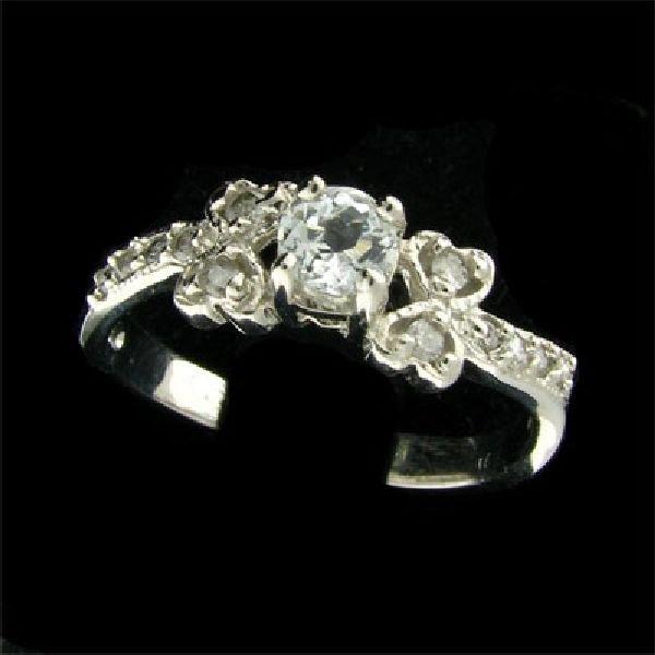14 kt. White Gold, 0.33CT Blue Topaz & Diamond Ring