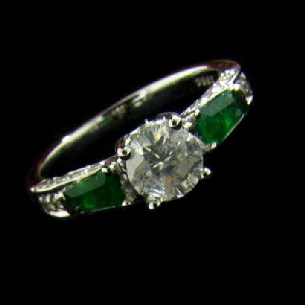 APP: 3.7k 14kt. White Gold .86CT Diamond & Emerald Ring