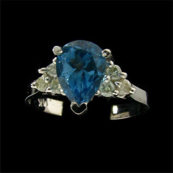 14 kt. White Gold, 1.50CT Blue Topaz & Diamond Ring