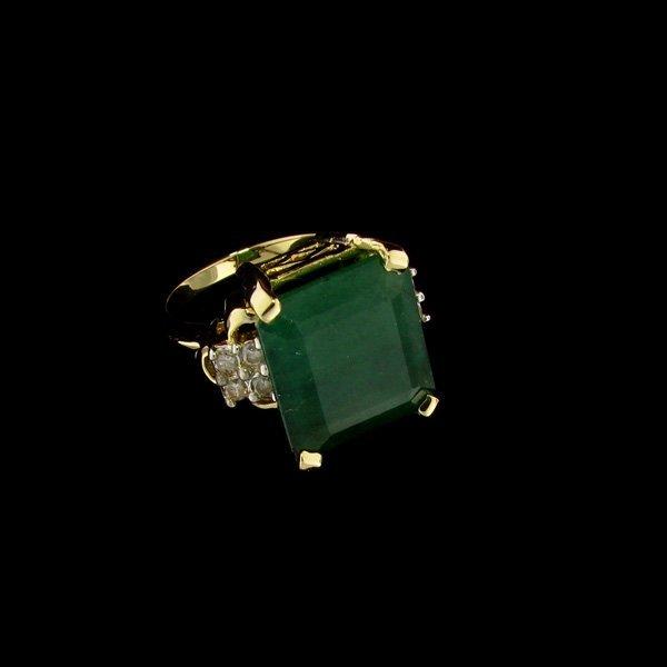 APP: 23.1k 14 kt. Gold, 7.69CT Emerald & Diamond Ring