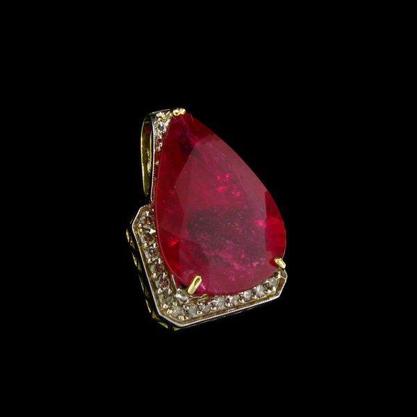 APP: 63.4k 14 kt. Gold, 33.92CT Ruby & Diamond Pendant
