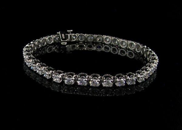 APP: 46.8k 14 kt. White Gold, 5.25CT Diamond Bracelet