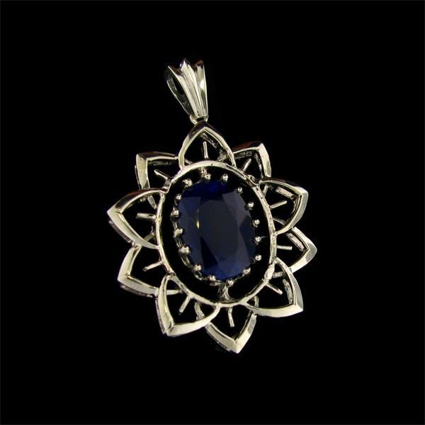 APP: 29k 13.2CT Blue Sapphire & Sterling Silver Pendant