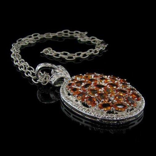 APP: 26k 17CT Orange Sapphire Silver & Diamond Pendant