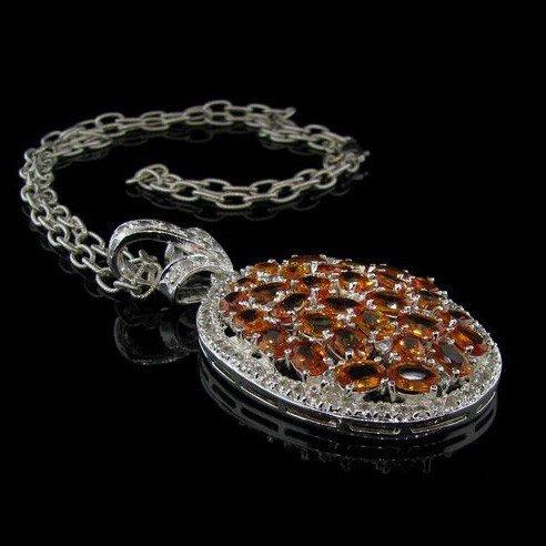 APP: 26k 17CT Orange Sapphire, Silver & Diamond Pendant
