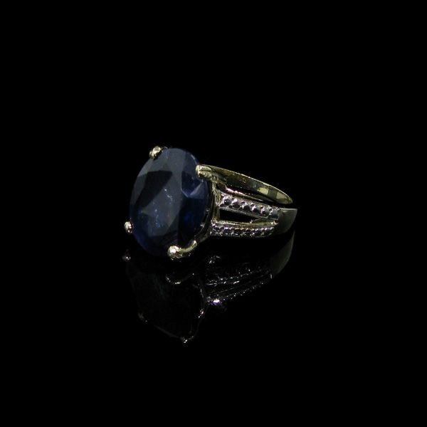APP: 19.2k 12.12CT 14 kt. Gold, Blue Sapphire Ring