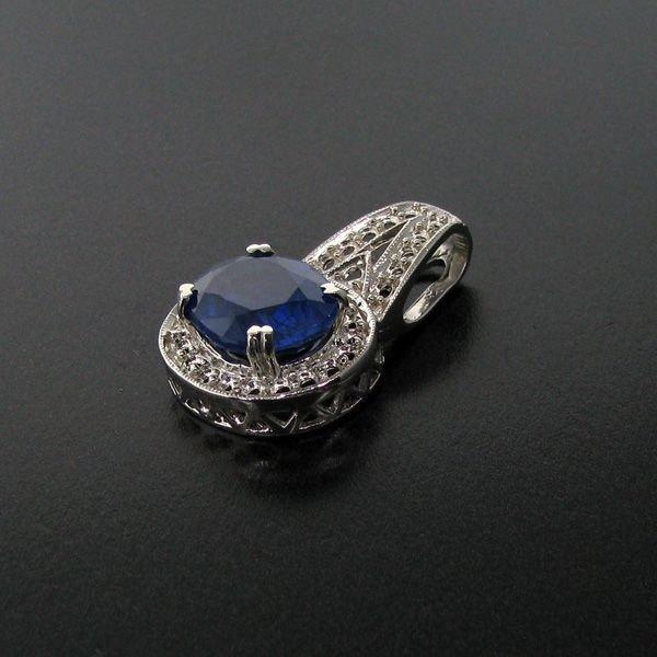 APP: 7k 11.61CT Blue Sapphire & Sterling Silver Pendant