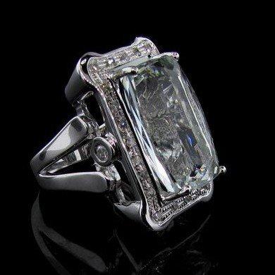 APP: 29k Silver 17CT Emerald & Diamond Ring