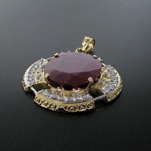 APP: 81.4k 14 kt. Gold, 55.71CT Ruby & Diamond Pendant