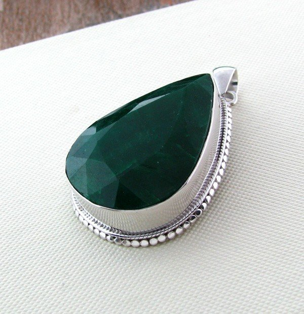 APP: 18.5k 118.76CT Emerald & Sterling Silver Pendant