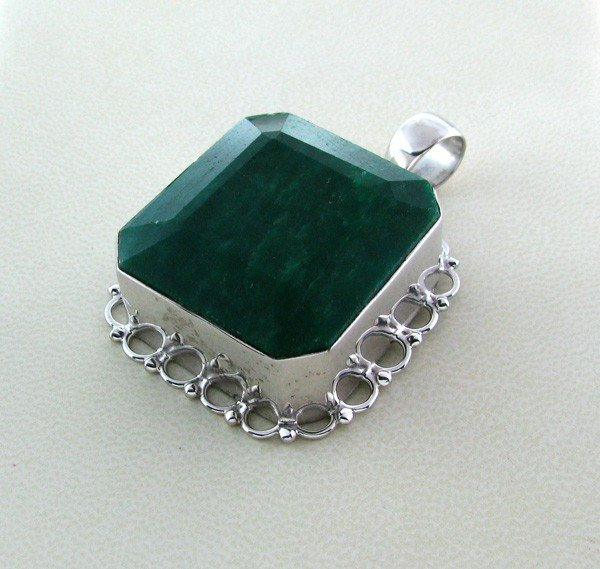 APP: 20.6k 134.00CT Emerald & Sterling Silver Pendant
