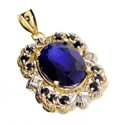 APP: 16.2k 14 kt. Gold, 10.86CT Blue Sapphire Pendant