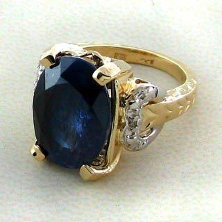 APP: 9.4k 14 kt. Gold, 10.21CT Blue Sapphire Ring