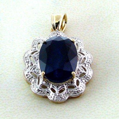 APP: 7.4k 14 kt. Gold, 11.42CT Blue Sapphire Pendant