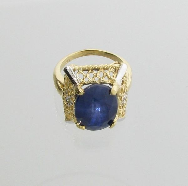 APP: 10.4k 14 kt. Gold,11.04CT Blue Sapphire Ring