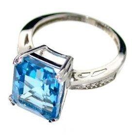 APP: 0k 7CT Emerald Cut Topaz & Diamond Silver Ring