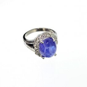 APP: 12k 14kt White Gold, 6CT Cabochon Tanzanite Ring