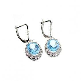 APP: 1k 8CT Oval Cut Topaz & Sterling Silver Earrings