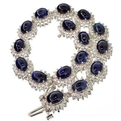 APP: 16k 25CT Cabochon Sapphire & Over Silver Bracelet