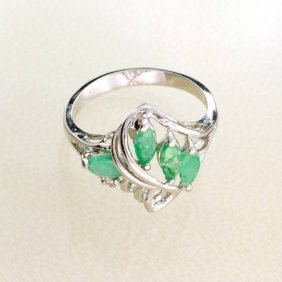 APP: 1k 0.65CT Emerald & Sterling Silver Ring