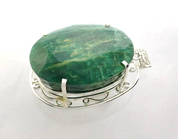 APP: 32k Sebastian 528CT Oval Emerald & Silver Pendant