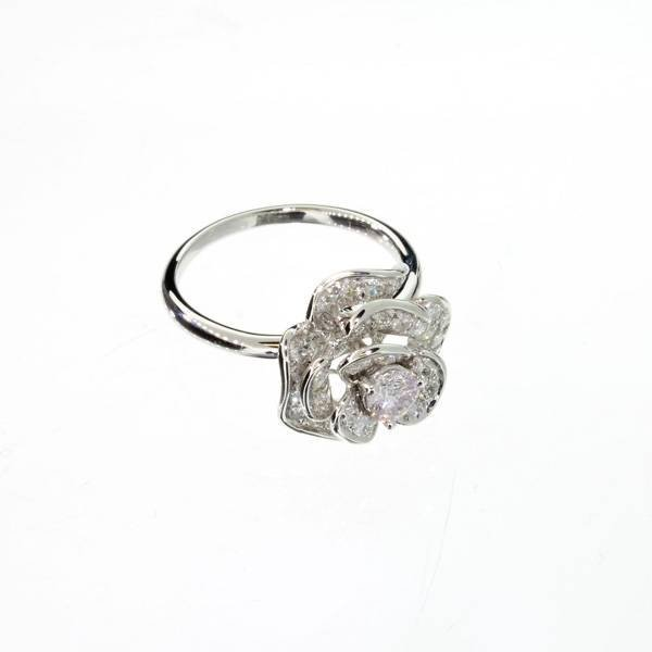 APP: 4k 18kt White Gold, 0.74CT Round Cut Diamond Ring