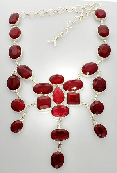 APP: 18k 348CT  Mixed Cut Ruby & Sterl Silver Necklace