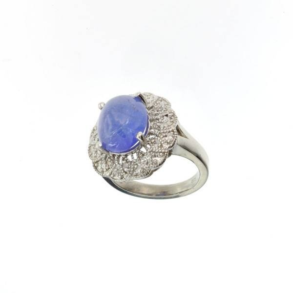 APP: 15k 14kt White Gold, 8 CT Oval Cut Tanzanite Ring