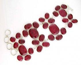 APP: 19k 93 CT Oval Cut Ruby & Sterling Silver Bracelet