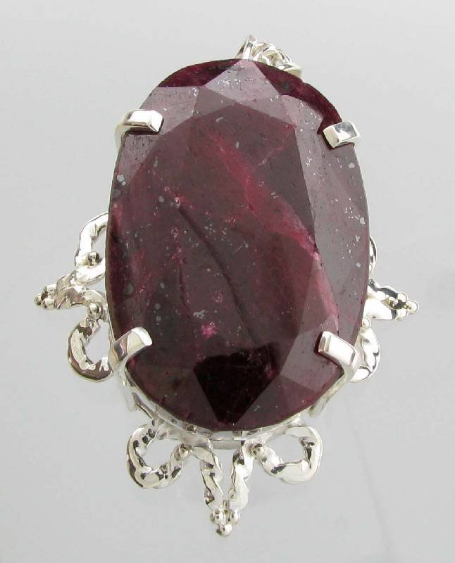 APP: 23k 333 CT Oval Cut Ruby & Sterling Silver Pendant