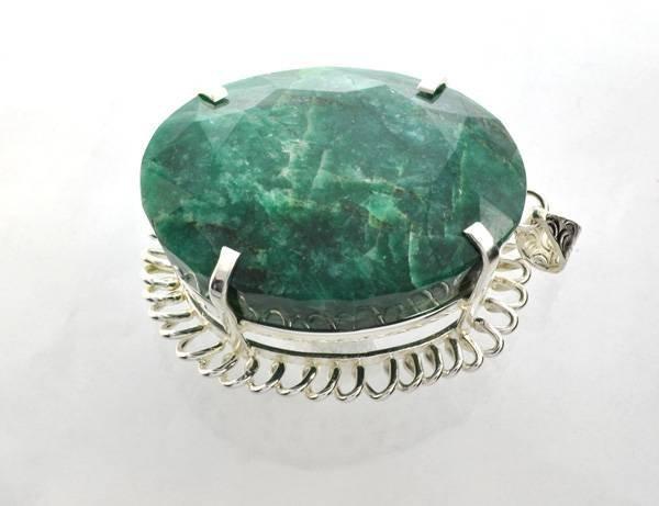 APP: 38k Sebastian 523CT Oval Emerald & Silver Pendant